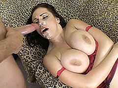 Big tit babe Angelica Sin mashes her bg breasts together for a titty fuck